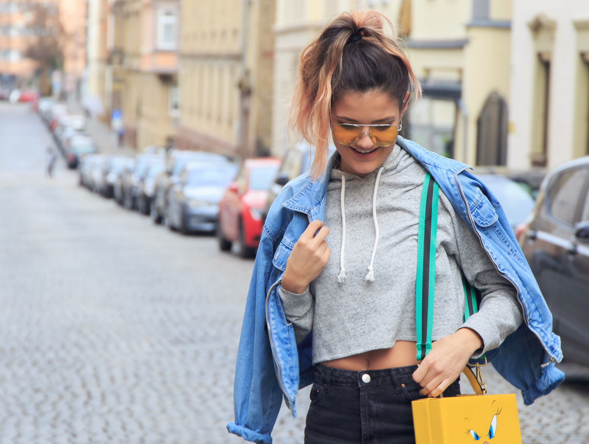 disney-purse-pastel-pink-hair-vintage-jeans-jacket-hoodie-outfit